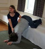 Gail Tully shows an expecting mother how to correctly do an inversion.